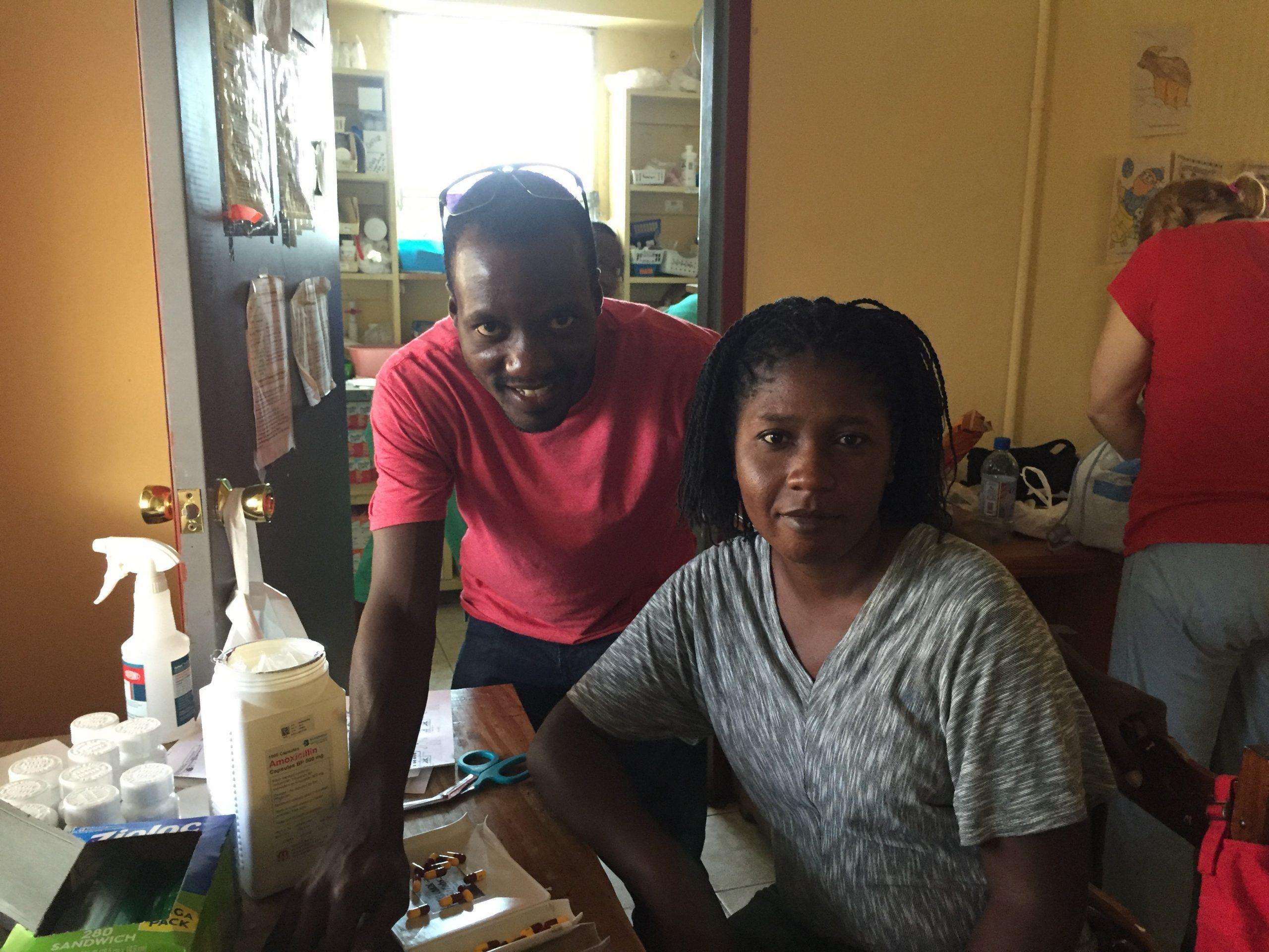 My Creole interpreter, Frisnel St. Julien and Jesulene, a volunteer from a district hospital pharmacy Image Credit: Grant McFadden