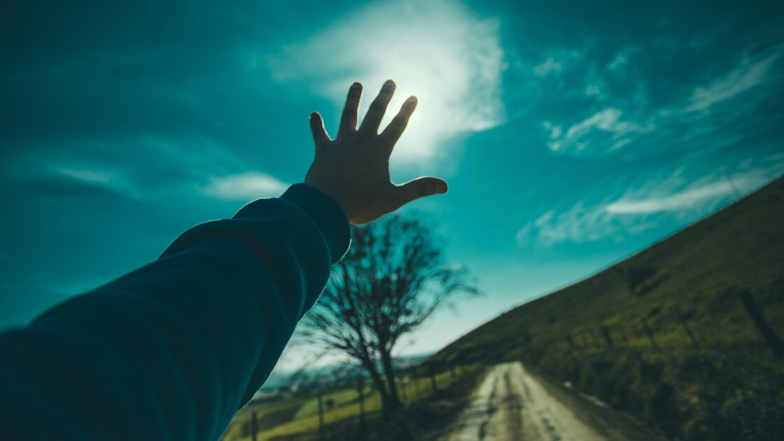 Hand reaching to the sky