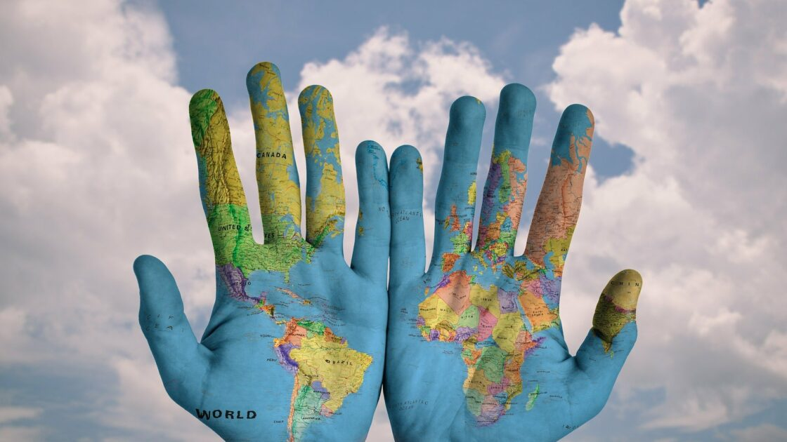 Hands painted with global map